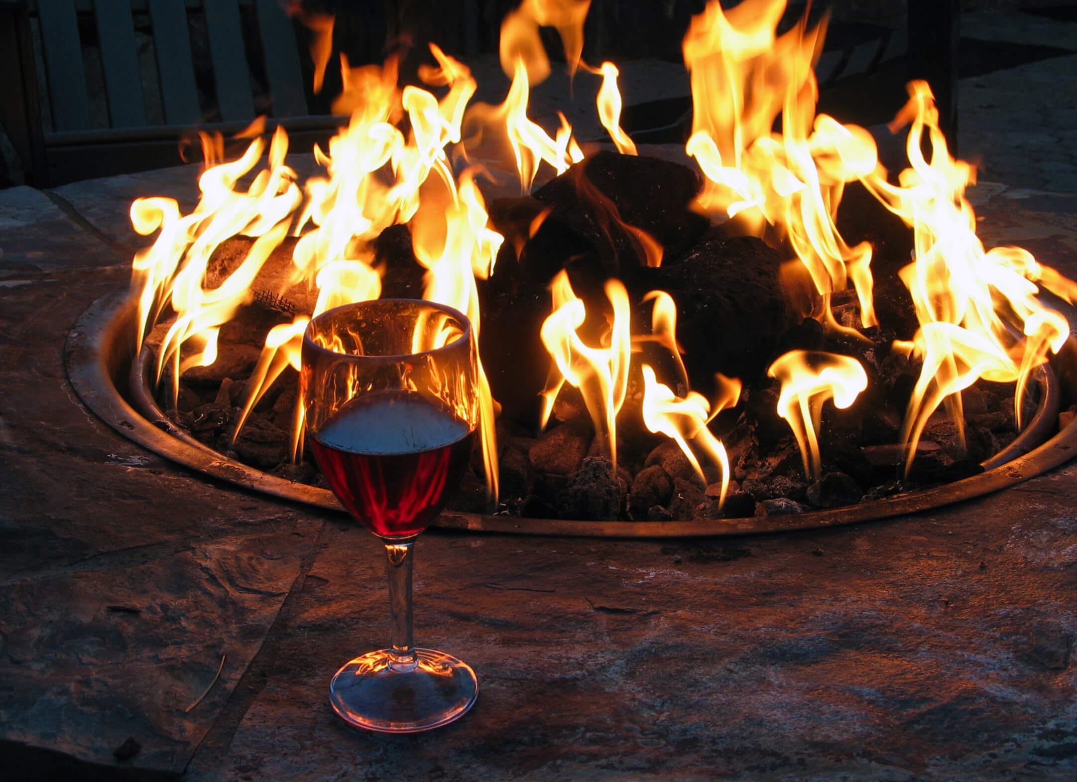 Wine glass by outdoor fire pit